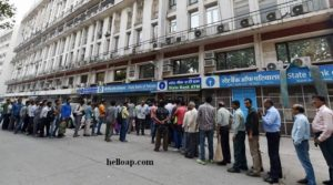 People queue up at ATM